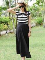 Dressกระโปรงผ้ายืด ด้านบนเป็นเป็นลายขวางขาวสลับดำ ด้านล่างเป็นผ้าสีดำล้วนมีสายคาดแนวตั้ง น่ารักน่าใส่มากๆค้ะ